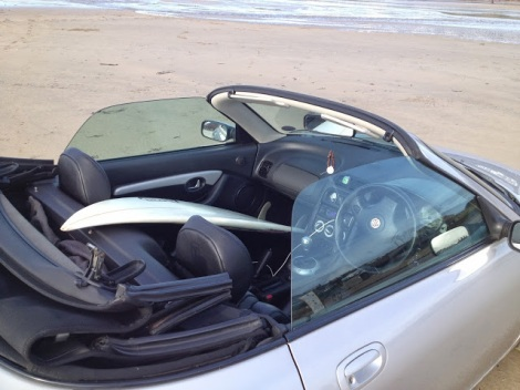 You can fit a surfboard in an MGF, but not a longboard