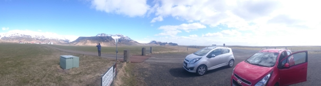 Two huge Chevrolets and one tiny volcano
