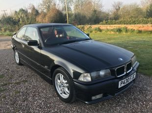 goodshoutmedia-bmw-e36-318is-black-with-red-leather-1