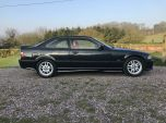goodshoutmedia-bmw-e36-318is-black-with-red-leather-12